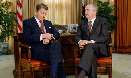 President Ronald Reagan checks his watch while talking to Soviet leader Mikhail Gorbachev in the White House.