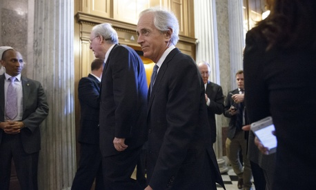 Sens. Bob Corker, R-Tenn., right, and Jay Rockefeller, D-W.Va., walk to the Senate chamber prior to a vote on Capitol Hill, on March 27, 2014.