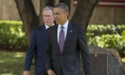 U.S. President Barack Obama, right, and former U.S. President George W. Bush walk on Tuesday, July 2, 2013.