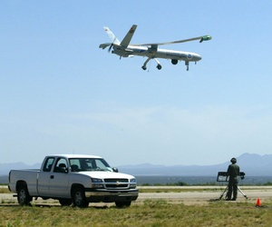 A Hermes 450 belonging to the U.S. Customs and Border Protection takes off from an airfield.