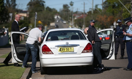 Police investigators search a car in the suburbs of Sydney, Australia, after intelligence agencies indicated a possible looming attack.