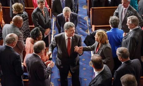 Ukrainian President Petro Poroshenko greets members of Congress after addressing a joint session of the legislature on Thursday.