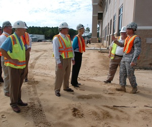 An NCO with the Army Central Advance Party speaks to members of the Sumter Chamber of Commerce during a tour of the construction site of the Third Army's new headquarters at Shaw Air Force Base.
