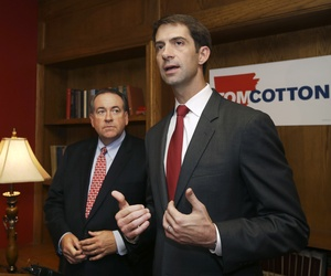 Rep. Tom Cotton, R-Ark., and former Arkansas Gov. Mike Huckabee, speak during an election event in Little Rock, Ark.