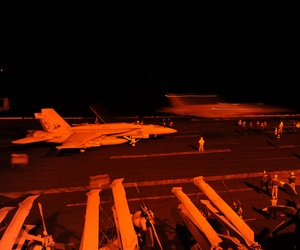An F/A 18 Super Hornet with the Strike Fighter Squadron 31 prepares to launch from the USS George H.W. Bush to strike ISIL targets in Syria, on September 23, 2014.