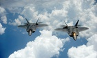 Two of the U.S. Air Force's F-22 Raptors in flight.