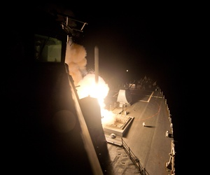 The guided-missile destroyer USS Arleigh Burke (DDG 51) launches Tomahawk cruise missiles to conduct strikes against ISIL targets, Sept. 23, 2014.