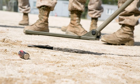 A U.S. Marine practices using a metal detector April 21, 2014, during Korean Marine Exchange Program 14-6 in Pohang, Republic of Korea.