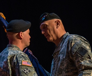 U.S. Army Gen. David Perkins receives the colors from U.S. Army Chief of Staff Gen. Ray Odierno during the U.S. Army Training and Doctrine Command (TRADOC), change of command ceremony at Joint Base Langley–Eustis, Va., on March 14, 2014.