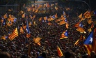 People wave flags symbolizing Catalonia's independence during a demonstration in Catalonia, Spain, on September 11, 2014.