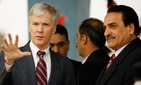 U.S. Ambassador to Iraq Ryan Crocker, left, and deputy interior minister Adanan al-Asadi, right, attend a ceremony marking Police Day in Baghdad, Iraq on Jan. 9, 2009.