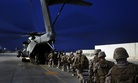 Marines with the 7th Marine Regiment load onto a CH-53E Super Stallion before a mission in Helmand province, Afghanistan, on June 5, 2014.