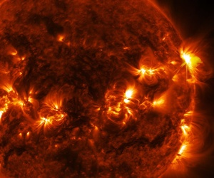 A solar flare erupts on the far right side of the sun, in this image captured by NASA's Solar Dynamics Observatory.