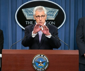 Defense Secretary Chuck Hagel is flanked by Deputy Defense Secretary Bob Work and Principal Deputy Undersecretary of Defense for Personnel and Readiness Dr. Laura Junor, during a Pentagon briefing, Oct. 1, 2014, to discuss the military health care system.