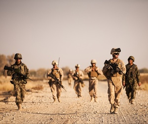 A group of Marines with the 3rd Marine Regiment provide security in Nawa, Afghanistan, on November 17, 2010.