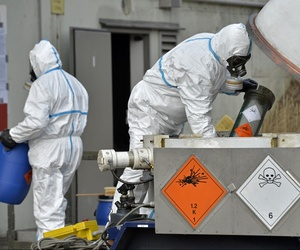 Experts at GEKA, a German state-run company, demonstrate the proper way to dispose chemical weapons. The company was tasked with dismantling Syria's chemical weapons program.