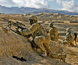 A soldier with the 10th Mountain Division provides security for ANSF troops in Kharwar District, on January 11, 2011.