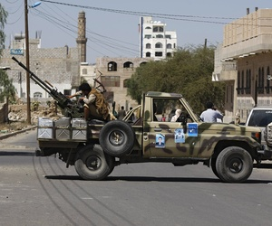 A Houthi Shiite rebel mans a machine gun on a military truck in Sanaa, Yemen, on October 20, 2014.