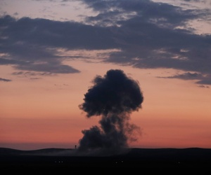 Smoke rises from an airstrike by the US-led coalition in Kobani, Syria while fighting continued between Syrian Kurds and the militants of Islamic State group, as seen from Mursitpinar on the outskirts of Suruc, at the Turkey-Syria border, Oct. 18, 2014.
