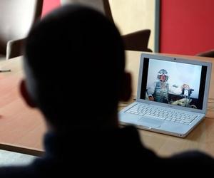 Iraq war veteran Dave Walker uses his computer.