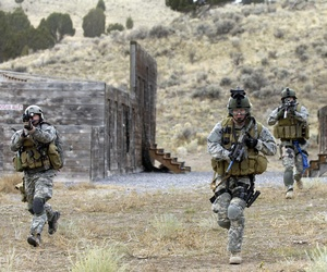 U.S. Army Soldiers with the 19th Special Forces conduct an urban village assault at Camp Williams, Utah.