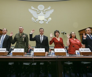 A panel of witnesses are sworn in on Capitol Hill in Washington, Friday, Oct. 24, 2014, prior to testifying before the House Oversight Committee hearing as lawmakers update their examination of the government's response to the Ebola outbreak.