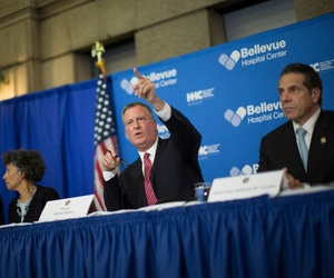 New York City Mayor Bill de Blasio, gestures at a news conference at Bellevue Hospital to discuss Craig Spencer, a Doctors Without Borders physician who recently returned to the city after treating Ebola patients in West Africa, Oct. 23, 2014.