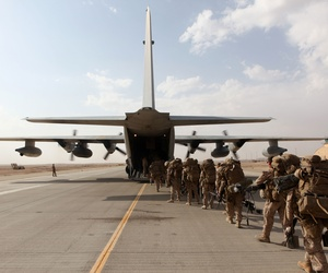 Marines and sailors with Marine Expeditionary Brigade - Afghanistan, load onto a KC-130 aircraft at Camp Bastion, on October 27, 2014.