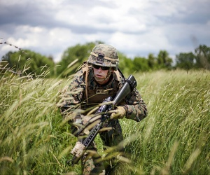 A corporal with the Black Sea Rotational Force 13 moves to his ambush position during a live-fire exercise in the Balta Verde Training Center in Romania, on March 14, 2013.