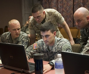 "A Naval Academy professor works with his teammates at the Army's Cyber Center of Excellence at Fort Gordon during ""NetWar,"" on June 10, 2014."