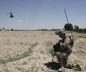 An Army sergeant communicates with air support during a cordon and search in the Ghazni province, Afghanistan, on May 18, 2012.