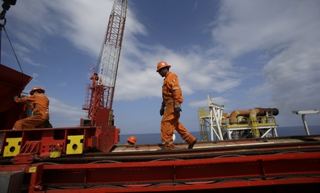 Workers prepare to move heavy equipment at the Centenario deep-water drilling platform off the coast of Veracruz, Mexico, on November 22, 2013.