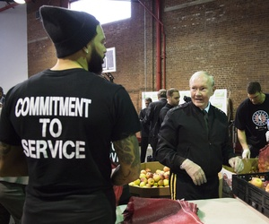 Joint Chiefs Chairman Gen. Martin Dempsey works with NBA Commissioner Adam Silver during a Commitment to Service event at a City Harvest food bank in New York, on November 6, 2014.