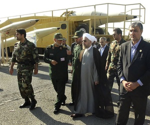 Iran's President Hassan Rouhani visits a defense industry display in Tehran, Iran, on August 24, 2014.