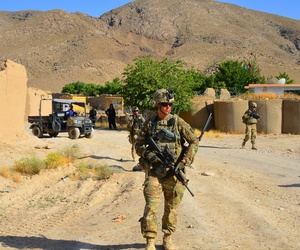 Capt. Tara Robertson, the commander of the Minnesota National Guard's 849th Mobility Augmentation Company, patrols in Afghanistan.
