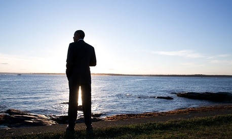 President Barack Obama looks out over the water after arriving aboard Marine One at the Brenton Point landing zone in Newport, R.I., Aug. 29, 2014.