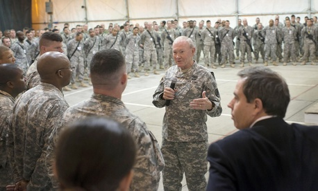 U.S. Chairman of the Joint Chiefs of Staff, Army Gen. Martin E. Dempsey addresses questions from U.S. military members during a town hall meeting in Baghdad, Iraq, Nov. 15, 2014.