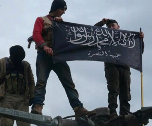 Al-Qaeda affiliated Jabhat al-Nusra insurgents wave their flags in Idlib province, northern Syria.