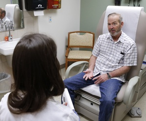 A veteran speaks with a doctor at the Veterans Administration Medical Center in Oklahoma City, Okla., on June 12, 2014.