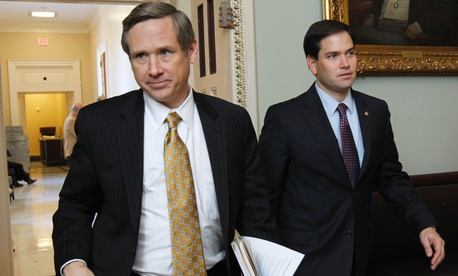 Sen. Mark Kirk, R-Ill., left, and Sen. Marco Rubio, R-Fla., leave a Republican caucus on Capitol Hill in Washington, Feb. 2, 2011.