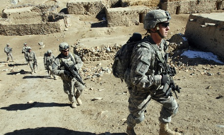 Soldiers with the 101st Airborne Division patrol a small village during an air assault mission in eastern Afghanistan, Nov. 4, 2008.