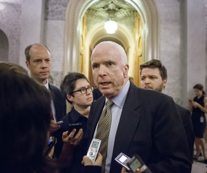 Sen. John McCain, R-Ariz., speaks to reporters as he leaves the Senate chamber after a roll call vote, at the Capitol in Washington, Wednesday, Nov. 12, 2014.