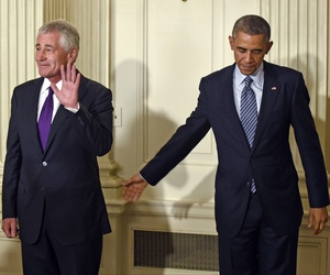 Defense Secretary Chuck Hagel stands with President Obama following an announcement where Hagel announced his resignation from the Pentagon.