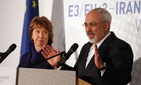 Iranian foreign minister Javad Zarif stands with former EU foreign policy chief Catherine Ashton on November 24, 2014.