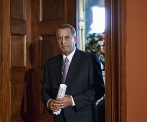 House Speaker John Boehner arrives at a press conference to respond to President Obama's executive action that spared millions of undocumented immigrants from being deported.