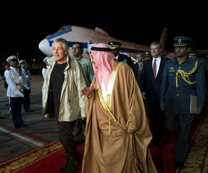 Defense Secretary Chuck Hagel is escorted through an honors ceremony by Bahraini Lt. Gen. Sheikh Mohammed Al Khalifa, in Bahrain, in advance of the 2013 Manama Dialogue.