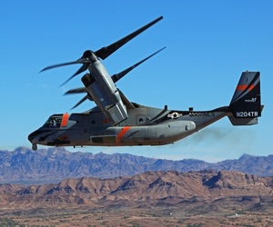 A V-22 Osprey fires a side-mounted rocket during a test at Yuma Proving Ground.