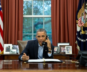 President Barack Obama talks on a conference call from the Oval Office with service members in Liberia and Senegal taking part in Operation United Assistance, the U.S. military campaign to contain the Ebola virus outbreak at its source, Nov. 1, 2014.