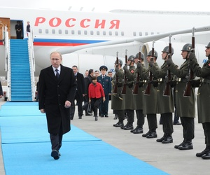 Russian President Vladimir Putin, reviews an honor guard as he walks upon arrival at Ankara airport in Turkey, on December 1, 2014.