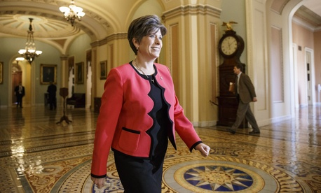 Sen.-elect Joni Ernst, R-Iowa strides through the halls of the Senate on Capitol Hill in Washington on Nov. 12, 2014.